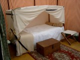 Canopied Bed (folds into trunk); Leather Trunk; Stool